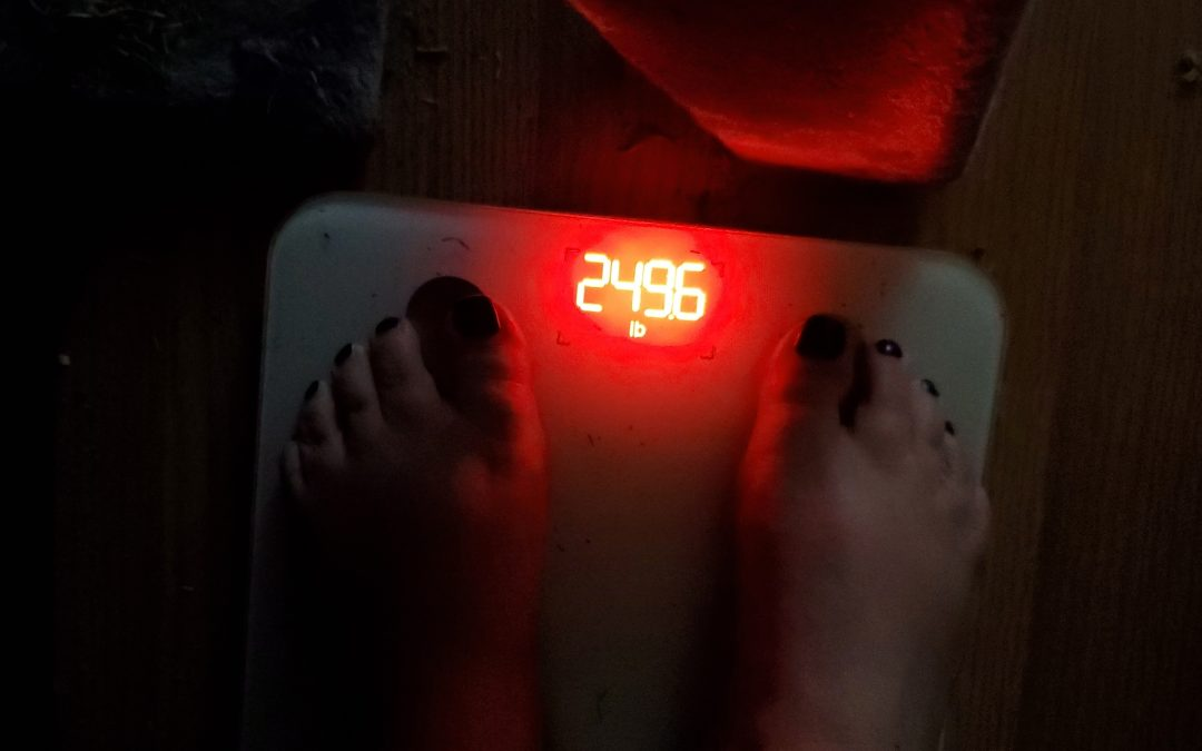 feet on scales weight 249